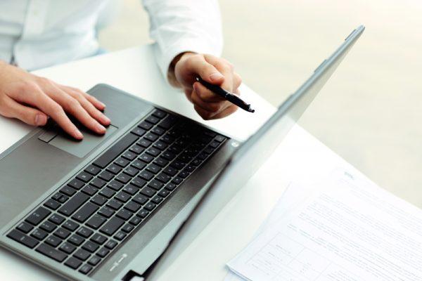 Bookkeeper working on laptop Reno, NV