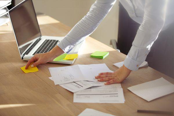 Bookkeeper organizing paperwork