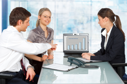 Business Group Reviewing chart on computer